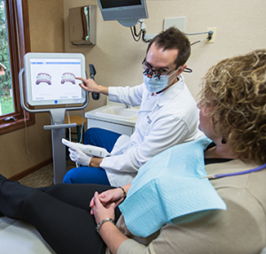 Dr. Felton shows Lolo patient how to straighten teeth without braces using Invisalign invisible braces in Missoula.